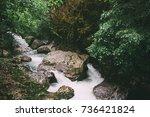 mountain river flowing through... | Shutterstock . vector #736421824