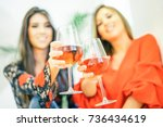 young women toasting glasses of ... | Shutterstock . vector #736434619