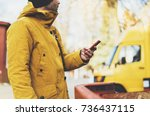 hipster with yellow backpack ... | Shutterstock . vector #736437115