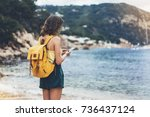 hipster girl with backpack hold ...   Shutterstock . vector #736437124