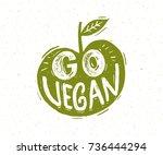 go vegan slogan. hand lettering ... | Shutterstock .eps vector #736444294