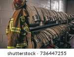 firefighter protection gear and ... | Shutterstock . vector #736447255