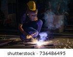 portrait of a welder working | Shutterstock . vector #736486495