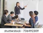 business people are discussing... | Shutterstock . vector #736492309