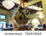 woman is holding icecream... | Shutterstock . vector #736513069
