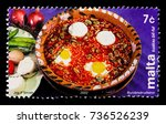 "Small photo of MOSCOW, RUSSIA - OCTOBER 3, 2017: A stamp printed in Malta shows ""Kusksu Bil-ful"" (bean stew), Maltese Cookery serie, circa 2002"