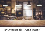 wood table top on blurred of... | Shutterstock . vector #736540054