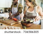 a couple is cooking in the... | Shutterstock . vector #736586305