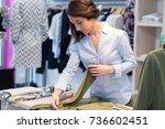 Clothing Shop Worker Folding...