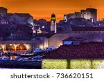 sunset over medieval town... | Shutterstock . vector #736620151