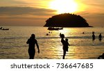 Small photo of Silhouette tourist familly mother is carrying her baby on sunshine is a beautiful picture on sea beach(visible,blurry,focus,imbalance,composition)