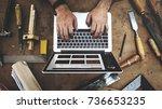 craftsman working in a wood shop | Shutterstock . vector #736653235