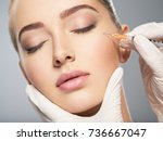 woman getting cosmetic... | Shutterstock . vector #736667047