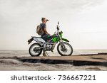man sitting on a motorcycle and ... | Shutterstock . vector #736667221