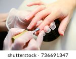 manicure in process | Shutterstock . vector #736691347