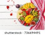 platter fruits and berries.... | Shutterstock . vector #736694491