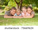 lovely family in the park | Shutterstock . vector #73669624