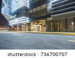 empty road with modern... | Shutterstock . vector #736700707