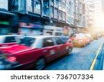 taxi on city street hong kong... | Shutterstock . vector #736707334