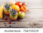 fresh fruit salad in jars on... | Shutterstock . vector #736723219