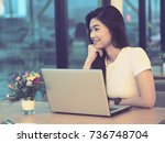 asian woman smile and working... | Shutterstock . vector #736748704