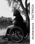Small photo of a young woman with instantaneous invalidity in wheelchairs by the river