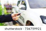 the car keys are in hand. | Shutterstock . vector #736759921