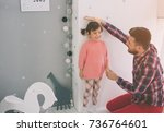 father is measuring his baby... | Shutterstock . vector #736764601
