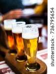 glass of beers on wooden table | Shutterstock . vector #736795654