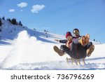 young couple sledding and... | Shutterstock . vector #736796269