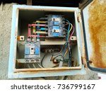 an old and rusty electric... | Shutterstock . vector #736799167