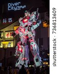 Small photo of Tokyo, Japan. September 26th 2017. Introduction to latest 1 to 1 life size model of Gundam RX-0 in both Unicorn mode and Destroy Mode at Diver City, Odaiba.