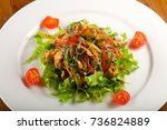 hot salad with chicken and... | Shutterstock . vector #736824889