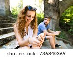 young couple with smartphones... | Shutterstock . vector #736840369