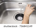 Small photo of pour a spoon of baking soda and a glass of vinegar respectively into the drain of sink, kitchen tips for effectively get rid of unpleasant smells