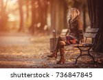 young woman sitting on bench in ... | Shutterstock . vector #736847845