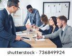 businesspeople having... | Shutterstock . vector #736849924