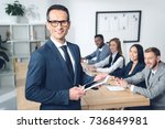 handsome young businessman... | Shutterstock . vector #736849981