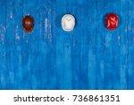 working helmets on a blue wall    Shutterstock . vector #736861351