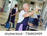cleaning team mopping floor... | Shutterstock . vector #736863409