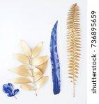 golden and blue gold leaf.... | Shutterstock . vector #736895659