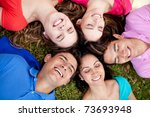 happy group of friends lying on ... | Shutterstock . vector #73693948