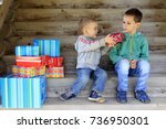 children and boxes with gifts.... | Shutterstock . vector #736950301