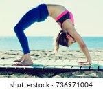 pretty adult girl practicing... | Shutterstock . vector #736971004
