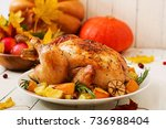 roasted turkey garnished with... | Shutterstock . vector #736988404
