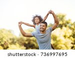 portrait of young father... | Shutterstock . vector #736997695