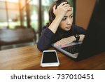 young business woman depressed... | Shutterstock . vector #737010451