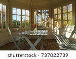 summer house on a sunny autumn... | Shutterstock . vector #737022739