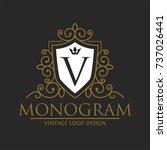 shield gold monogram logo... | Shutterstock .eps vector #737026441