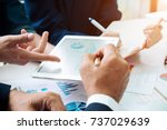 asian business adviser meeting... | Shutterstock . vector #737029639